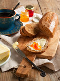 Breakfast with coffee, bread, butter and jam Stock Photography