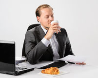 Breakfast coffee and bread at work Stock Photo