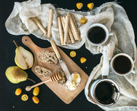 Breakfast / coffee break set: a pot (cezve) of coffee, two cups Royalty Free Stock Photo
