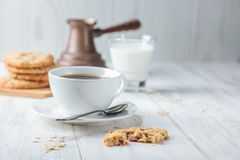 Breakfast with coffee. And oatmeal cookies Stock Photos