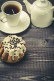 Breakfast: coffee with cake and milk/breakfast: coffee with cake and milk on a dark wooden background. Top view and copyspace. Dessert biscuit pastries cupcake royalty free stock photography