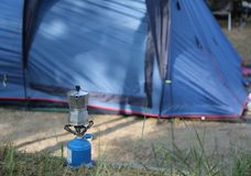 Breakfast with coffee at a campsite. Breakfast with coffee warming up on a camp stove at a campsite stock photos