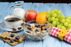 Breakfast with coffee, cereal and fruits selection Stock Images