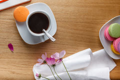 Breakfast with coffee, colorful macaron and open diary Stock Image