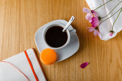 Breakfast with coffee, colorful macaron and open diary Stock Photography