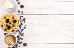 Breakfast with coffee, corn flakes, milk and berry . Stock Photos