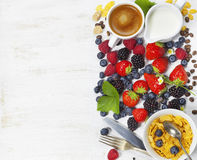 Breakfast with coffee, corn flakes, milk  and berry Royalty Free Stock Photography