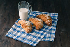 Breakfast with coffee crema, milk, fresh croissants on vintage o Stock Photos