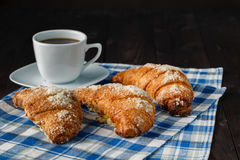 Breakfast with coffee crema, milk, fresh croissants on vintage o Stock Image