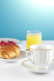 Breakfast with coffee and croissant Stock Image