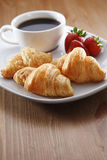 Breakfast with coffee and croissant Stock Photos