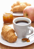 Breakfast with coffee and croissant. Classic breakfast with coffee and croissant Royalty Free Stock Image