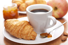 Breakfast with coffee and croissant. Breakfast with coffee and fresh croissant Royalty Free Stock Images