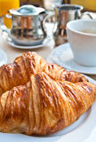 Breakfast with coffee and croissant. S in a basket on table Stock Photography