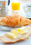 Breakfast coffee with croissant. Croissant with butter, coffee and orange juice Stock Images