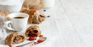 Breakfast with coffee and croissant. With strawberry jam close up stock photos