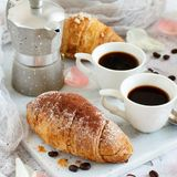 Breakfast with coffee and croissant. Close up with coffee beans royalty free stock image