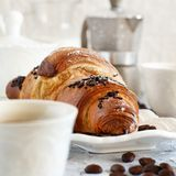 Breakfast with coffee and croissant. Close up with coffee beans stock photography