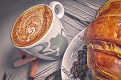 Breakfast with coffee and croissant. Closeup view Stock Photos
