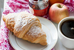 Breakfast with coffee and croissant. Breakfast with croissants, cup of black coffee and fruit Stock Photo