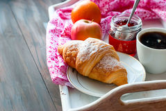 Breakfast with coffee and croissant. Breakfast with croissants, cup of black coffee and fruit Royalty Free Stock Images