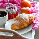 Breakfast with coffee and croissant. Breakfast with croissants, cup of black coffee and fruit Stock Photos