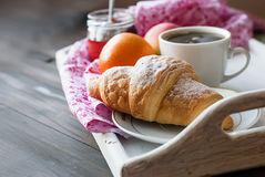 Breakfast with coffee and croissant. Breakfast with croissants, cup of black coffee and fruit Royalty Free Stock Photography