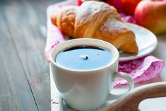 Breakfast with coffee and croissant. Breakfast with croissants, cup of black coffee and fruit Royalty Free Stock Image