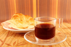 Breakfast with coffee and croissant Stock Images