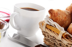 Breakfast of coffee, croissant, jam and butter Royalty Free Stock Images