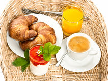 Breakfast with coffee, croissant and orange juice. Breakfast with coffee, orange juice, fresh strawberry yogurt and croissant Stock Image