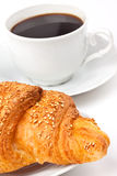 Breakfast: coffee and croissant with sesame seeds Stock Photography