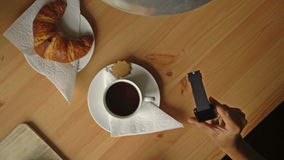 Breakfast With Coffee, Croissant And A Smart Watch. Top View. Dolly. stock video