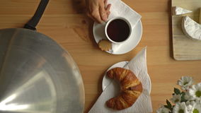 Breakfast With Coffee, Croissant And A Smart Watch. Top View. Dolly. stock video footage