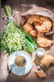 Breakfast with coffee, croissant and spring flowers. On old table Royalty Free Stock Photography