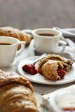 Breakfast with coffee and croissant. With strawberry jam close up royalty free stock photos
