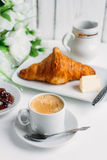 Breakfast with coffee, croissant and strawberry jam Stock Image