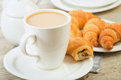 Breakfast with coffee and croissant. On table Stock Photo