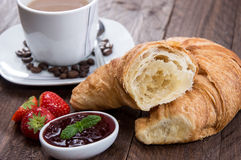 Breakfast with Coffee and Croissant. On wooden background Stock Photo