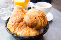 Breakfast with coffee and croissants in a basket Royalty Free Stock Photo