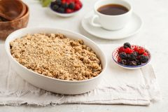 Breakfast with coffee and crumble pie, white background, healthy. Breakfast concept. Vegan berry dessert stock photography