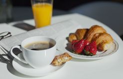 Breakfast. Coffee cup and croissant Stock Image
