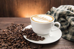 Breakfast coffee cup and croissant on wooden background Royalty Free Stock Images