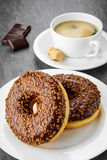 Breakfast with coffee and donuts Stock Photos