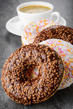 Breakfast with coffee and donuts Stock Images