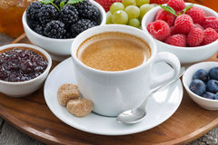 Breakfast with coffee and fresh berries, close-up. Horizontal Royalty Free Stock Images