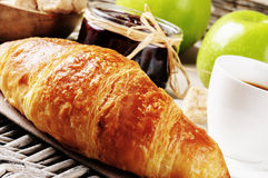 Breakfast with coffee, fresh croissant and fruits Stock Photography