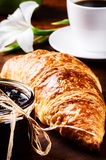 Breakfast with coffee and fresh croissant with jam Royalty Free Stock Photography