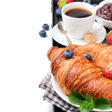 Breakfast with coffee and fresh croissants Royalty Free Stock Photos
