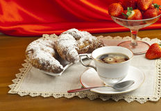 Breakfast with coffee , fresh croissants and strawberries. Stock Images